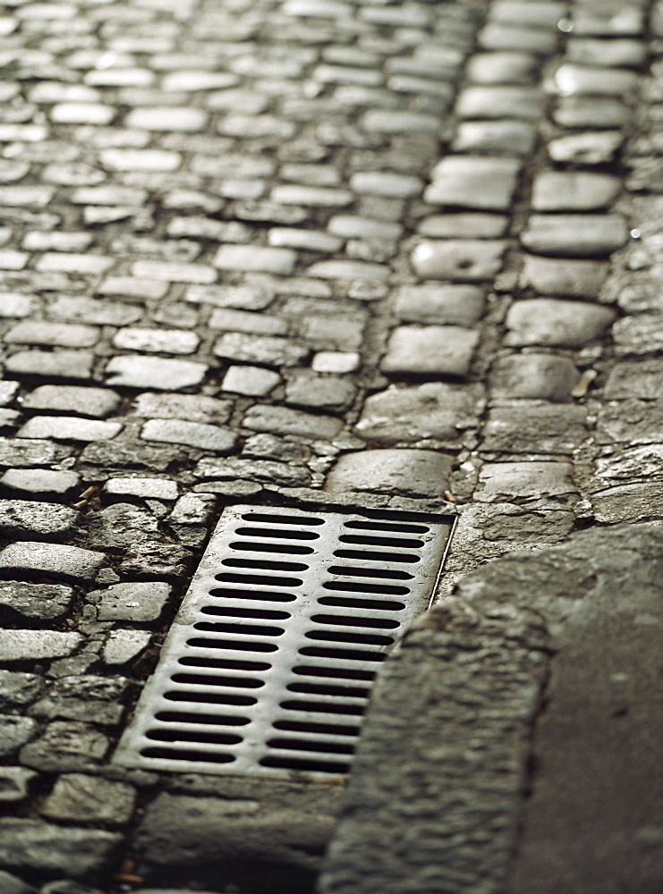 Cobbled road and drain near St. Tropez, Cote d'Azur, Provence, France, Europe