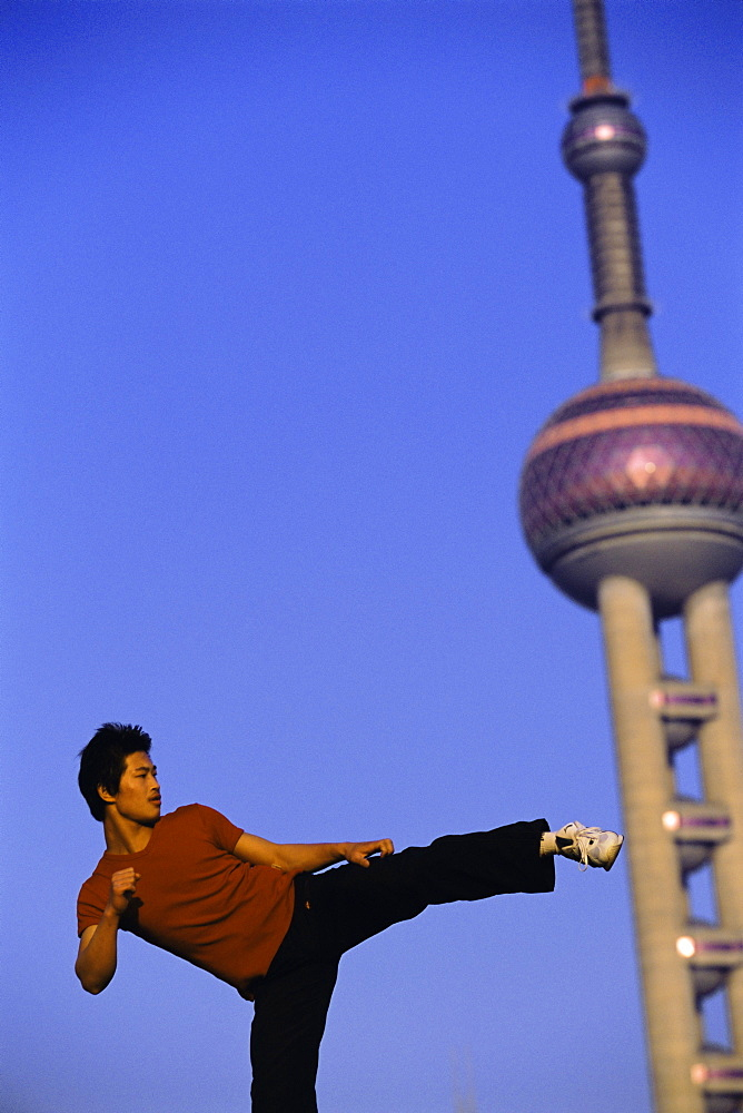 Boy practising martial arts, Shanghai, China, Asia
