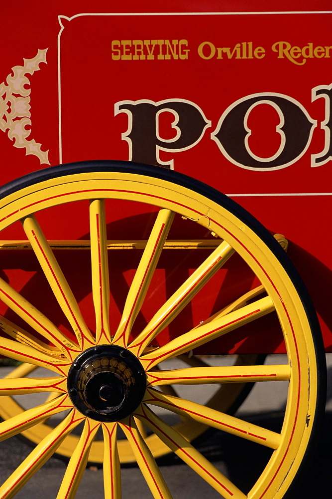 Close-up of yellow wheel on red cart, Disney MGM Studios, Orlando, Florida, United States of America (U.S.A.), North America