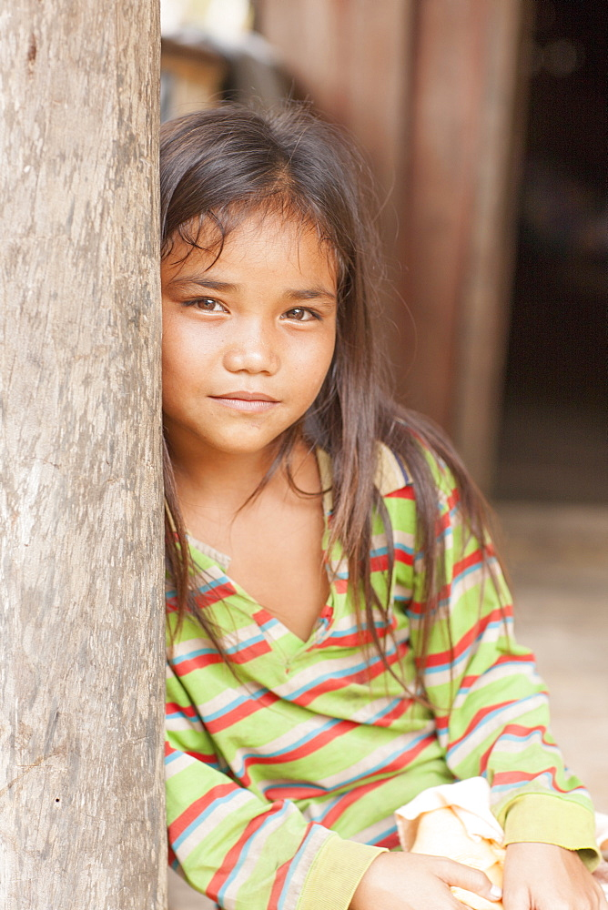 Girl in doorway, Laos, Indochina, Southeast Asia, Asia