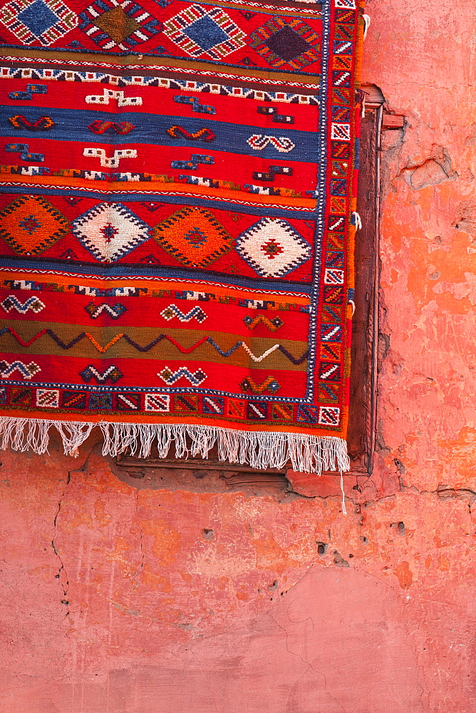 Carpet hanging on red wall, Marrakech, Morocco, North Africa, Africa