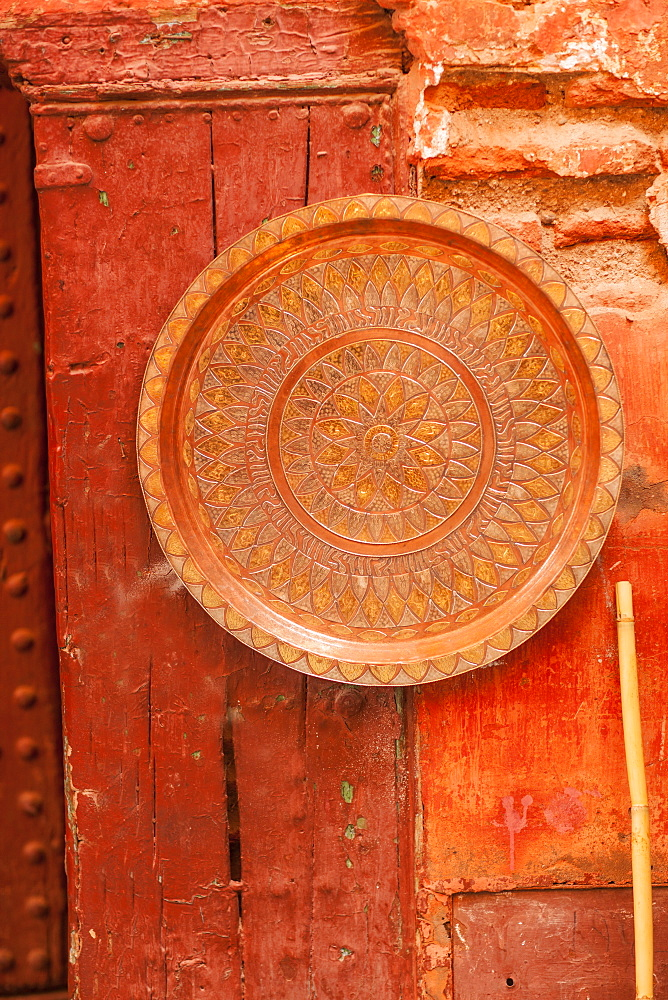 Copper plate on wall in the Medina, Marrakech, Morocco, North Africa, Africa
