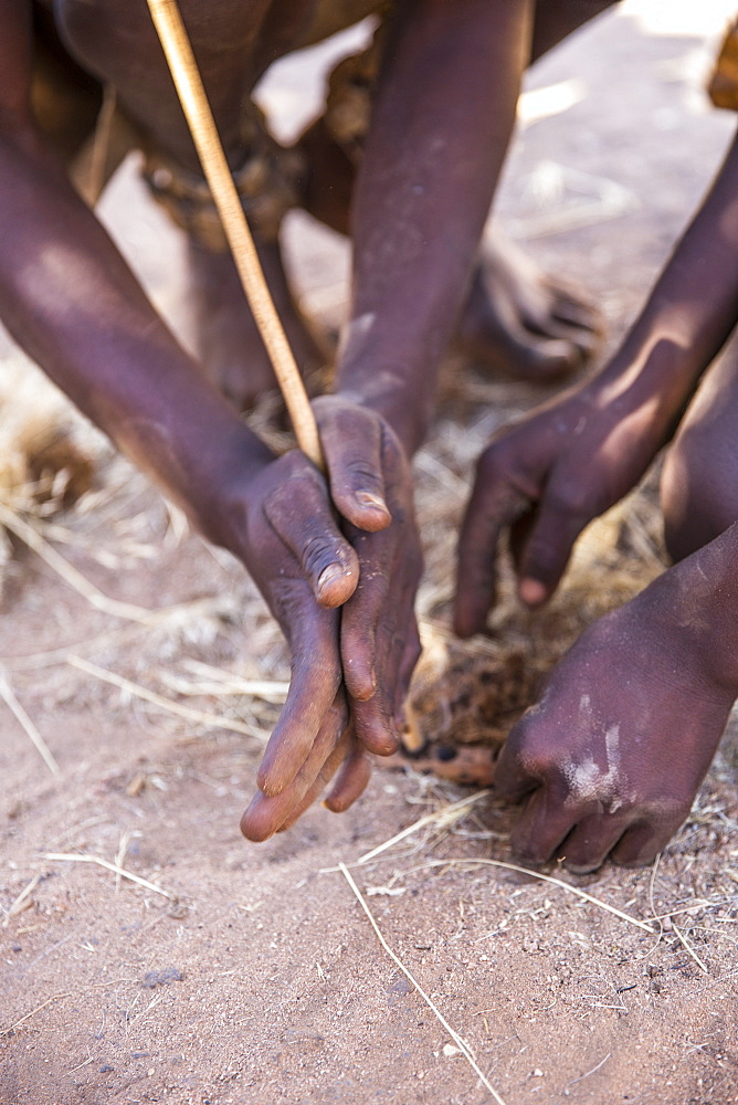 Himba men lighting a fire, North Namibia, Namibia, Africa