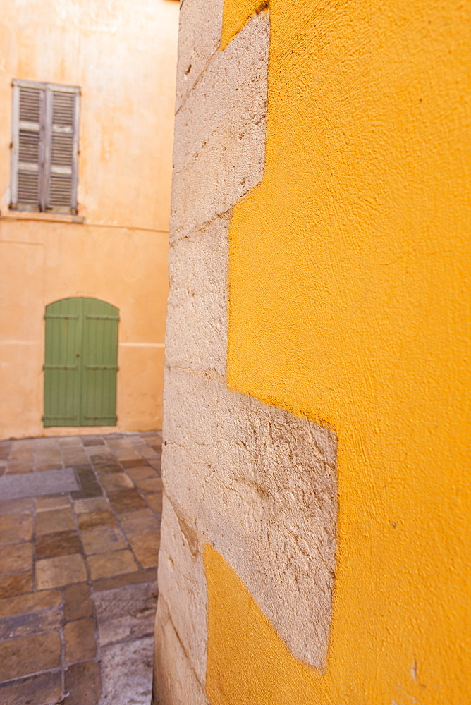 Yellow wall and green door, St. Tropez, Var, Provence, Cote d'Azur, France, Europe