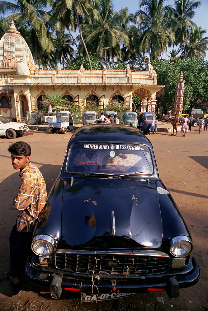 Car with message on windscreen, Mother Mary Bless our Way, in the street, Goa, India, Asia