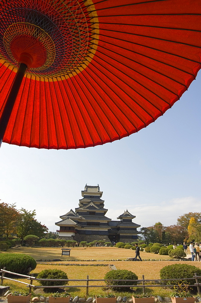 Matsumoto Castle under red parasol, Nagano prefecture, Kyoto, Japan, Asia