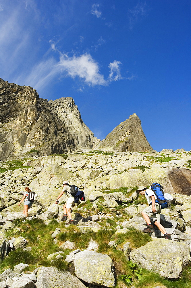 Hikers on trail, High Tatras Mountains (Vyoske Tatry), Tatra National Park, Slovakia, Europe