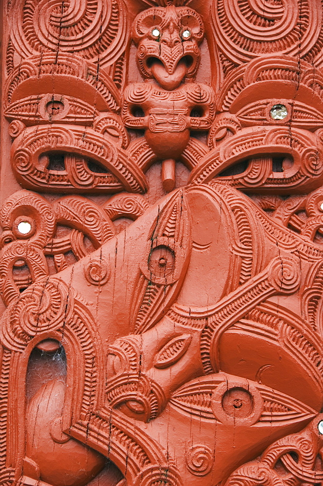Carvings on a Whare Whakairo Meeting House, carvings representing the dead and manifestations of ancestors preserved tribal history in an oral society, Te Puia Maori Village, Rotorua, Taupo Volcanic Zone, North Island, New Zealand, Pacific