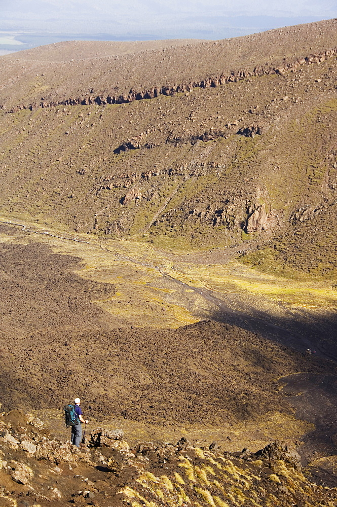 Hikers walking through a lava field on the Tongariro Crossing, Tongariro National Park, the oldest national park in the country, UNESCO World Heritage Site, Taupo Volcanic Zone, North Island, New Zealand, Pacific