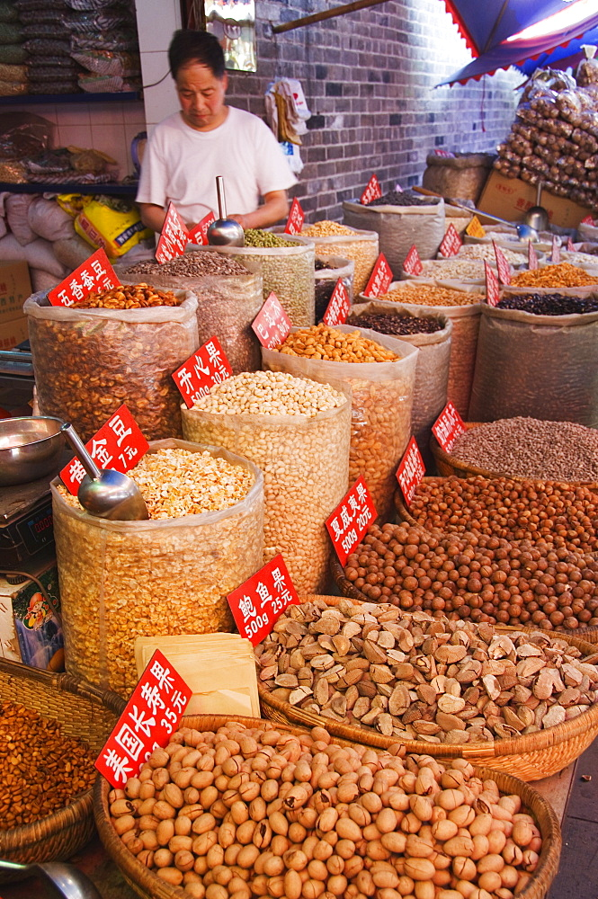 Vendor selling nuts at a market in the Muslim Quarter, home to the city's Hui community, Xian City, Shaanxi Province, China, Asia