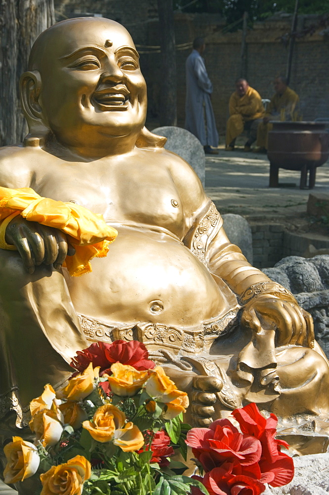 A golden Buddha statue at Shaolin Temple, birthplace of Kung Fu martial arts, Shaolin, Henan Province, China, Asia