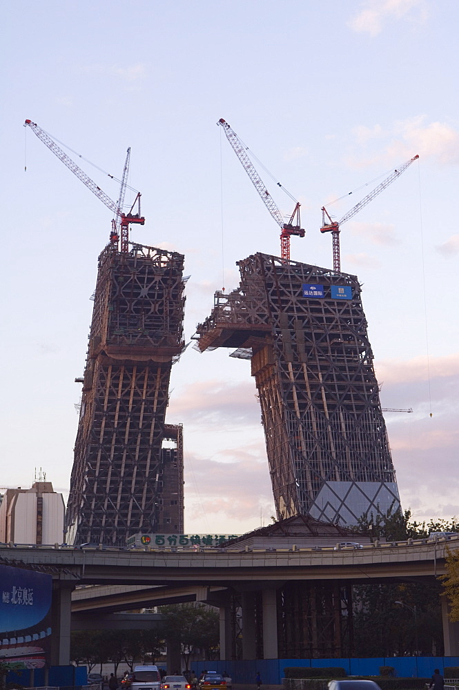 Partly contructed shell of the new CCTV tower building Guomao area, Beijing, China, Asia