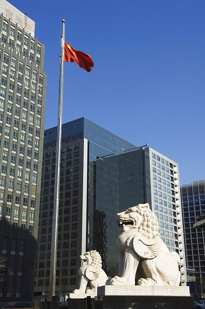 A stone lion statue in the CBD business district, Beijing, China, Asia