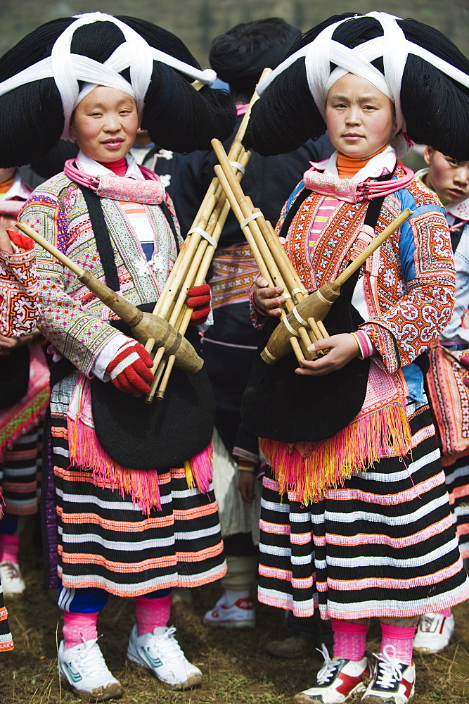 Long Horn Miao women at lunar New Year festival celebrations in Sugao ethnic village, Guizhou Province, China, Asia - 733-3302