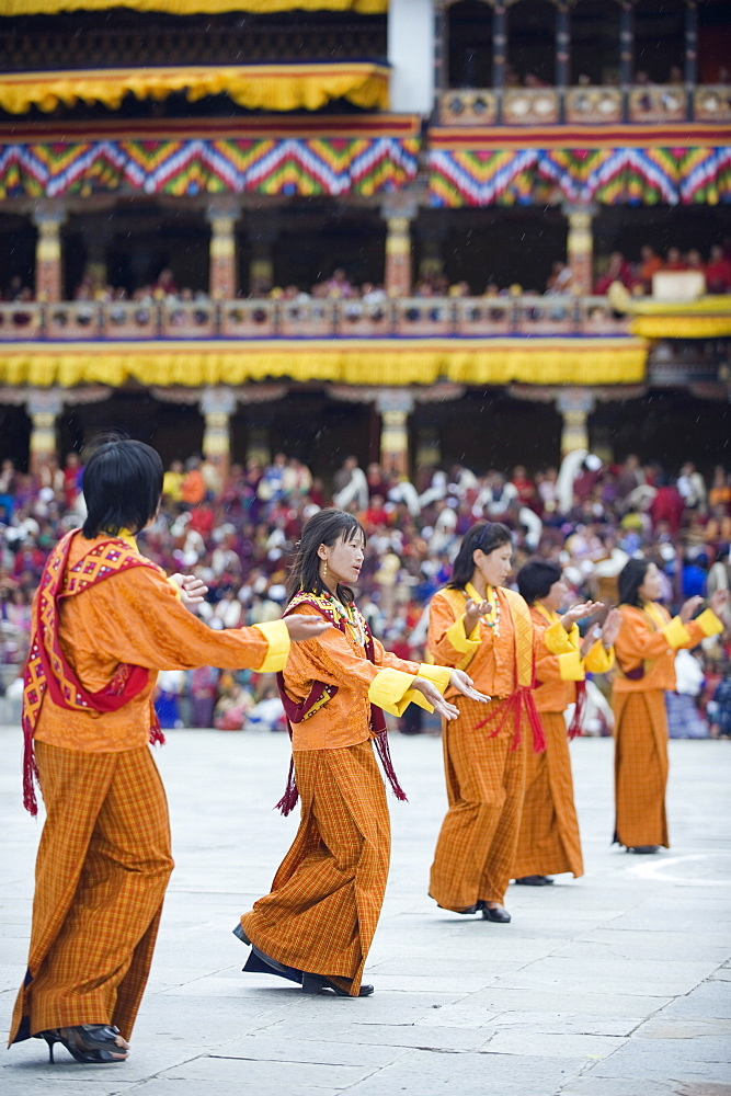 Dancers in traditional costume, Autumn Tsechu (festival) at Trashi Chhoe Dzong, Thimpu, Bhutan, Asia