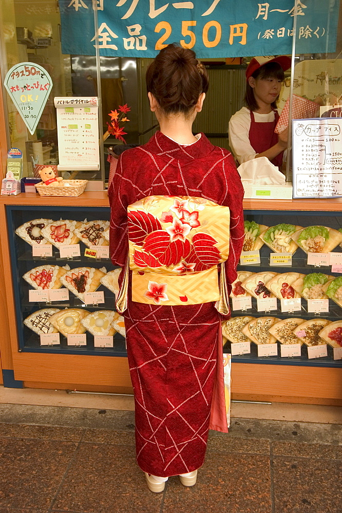 Girl in kimono, yukata buying crepe, Kyoto city, Honshu, Japan, Asia - 733-430