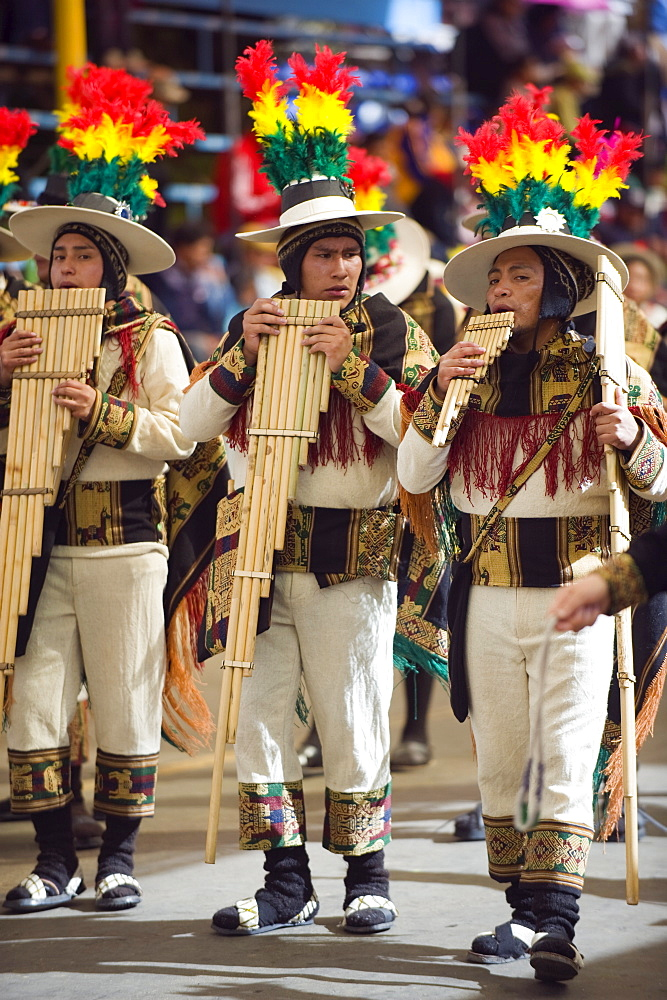Musicians playing the flute during Oruro Carnival, Oruro, Bolivia, South America