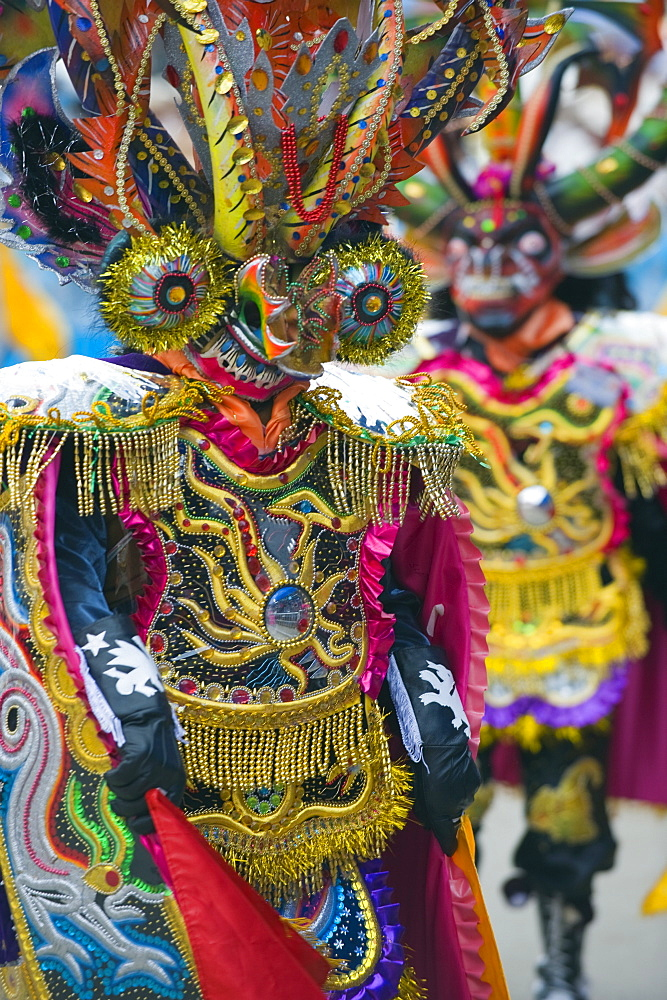 Masked performers in a parade at Oruro Carnival, Oruro, Bolivia, South America