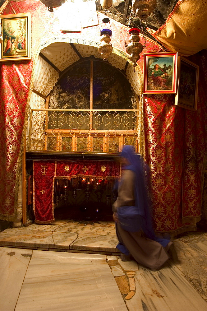 Nun inside the Church of the Nativity (birth place of Jesus Christ), Bethlehem, Israel, Middle East - 733-552