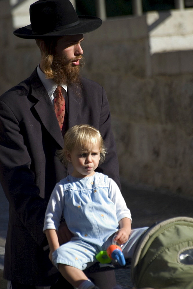 Jewish man in traditional clothes with child, Old Walled City, Jerusalem, Israel, Middle East