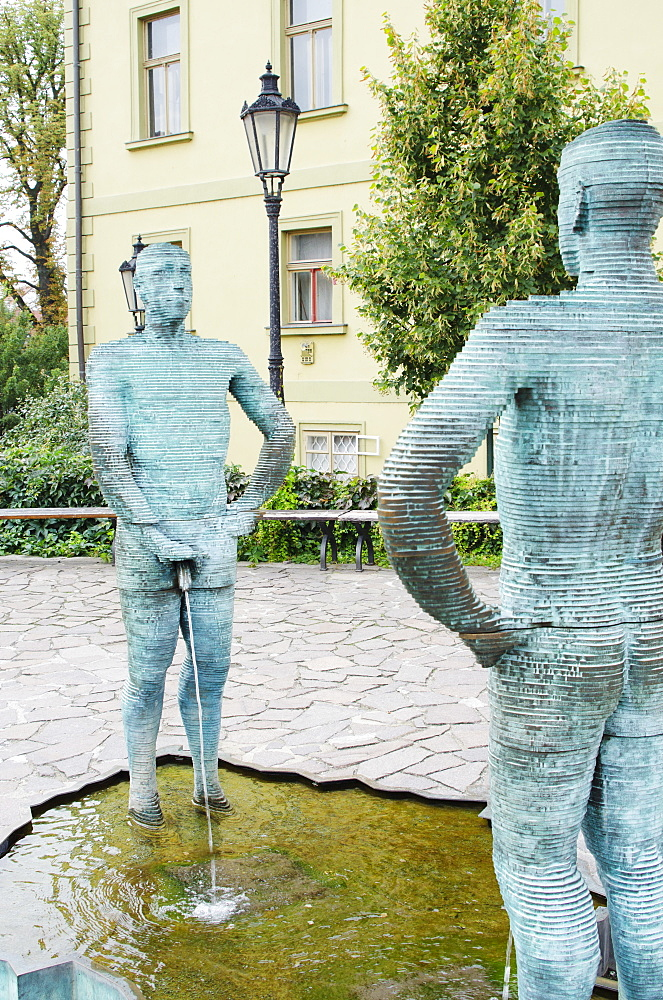 Pissing Men statue by David Cerny, Franz Kafka Museum, Prague, Czech Republic, Europe