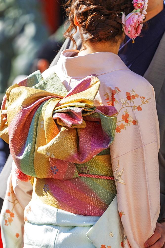 Asia, Japan, Tokyo, Asakusa, Sensoji temple, detail of a girl wearing a kimono