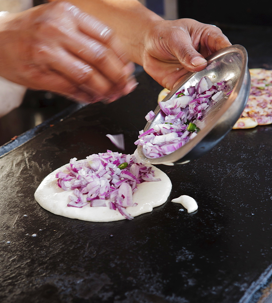 Street vendor making paratha naan with red onion, Rishikesh, Uttar Pradesh, India, Asia - 734-211