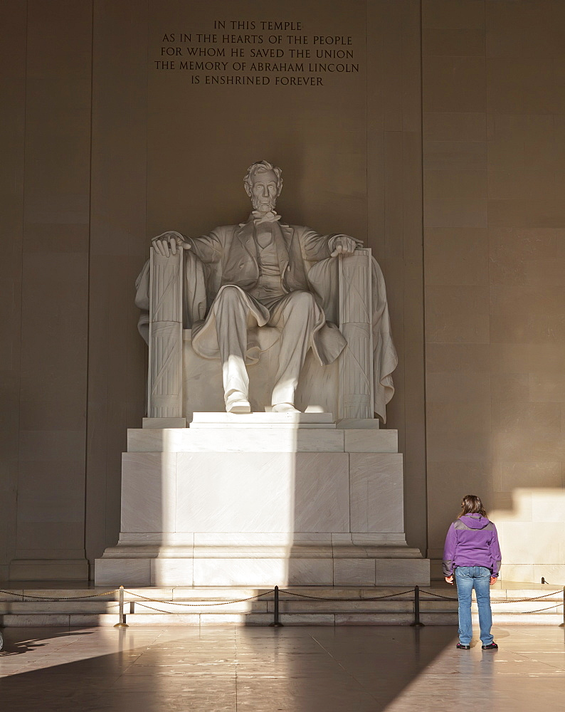 The statue of Lincoln in the Lincoln Memorial being admired by a young girl, Washington D.C., United States of America, North America - 734-247