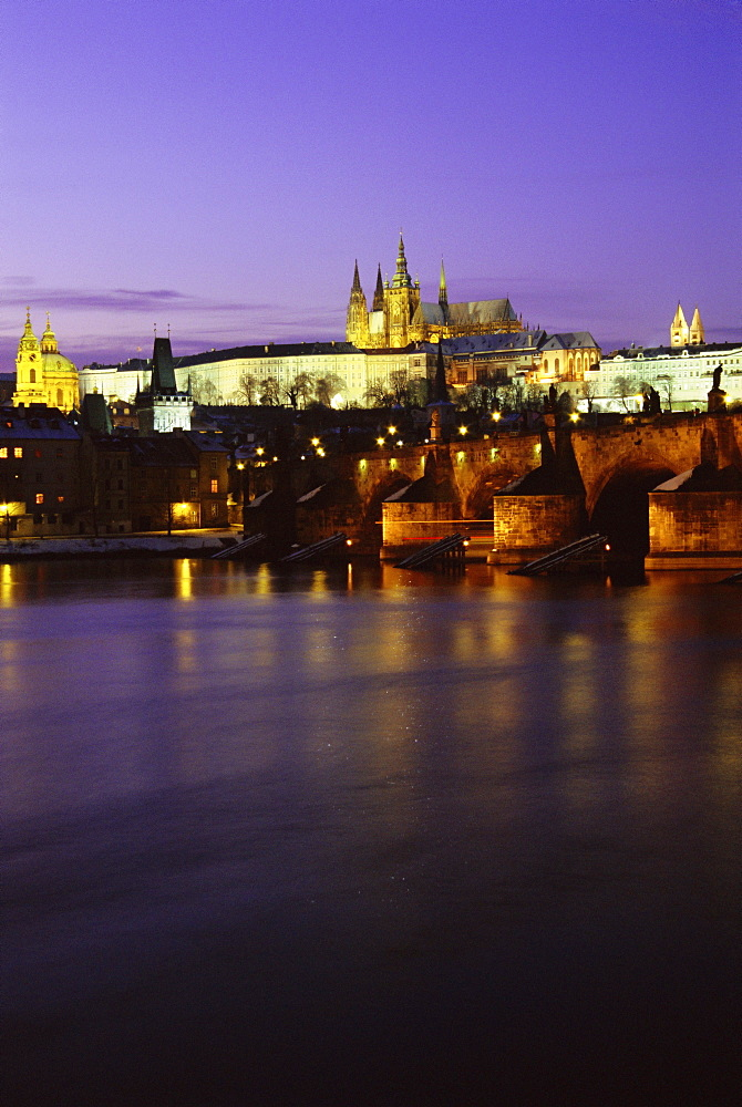 Charles Bridge, Vltava River, Mala Strana and Prague Castle at twilight during winter, Mala Strana, Prague, Czech Republic, Europe