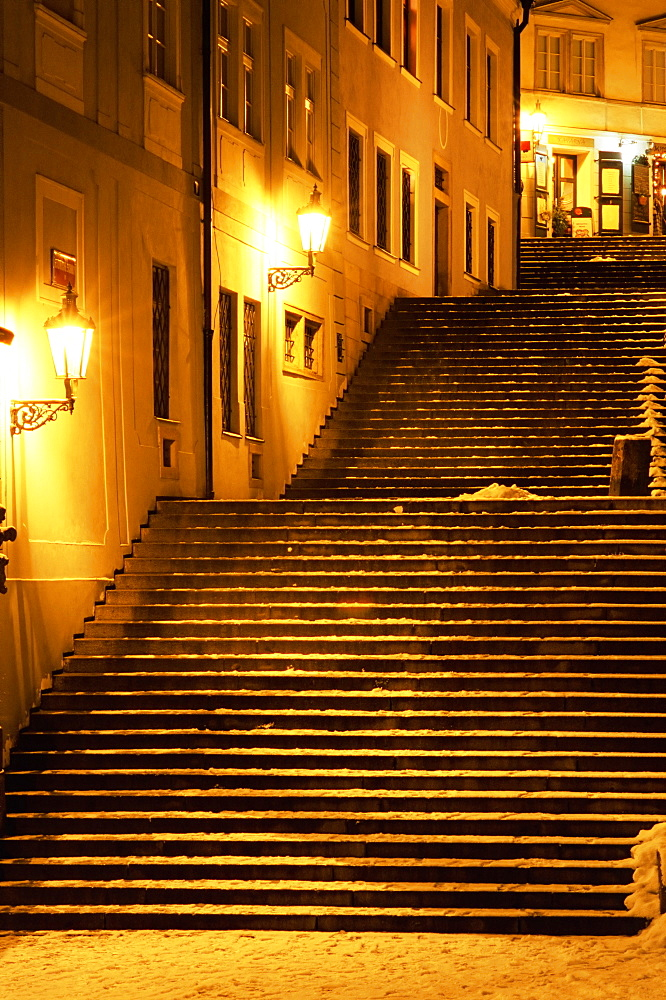 Snow covered Radnicke Steps in Mala Strana suburb at night, Prague, Czech Republic, Europe