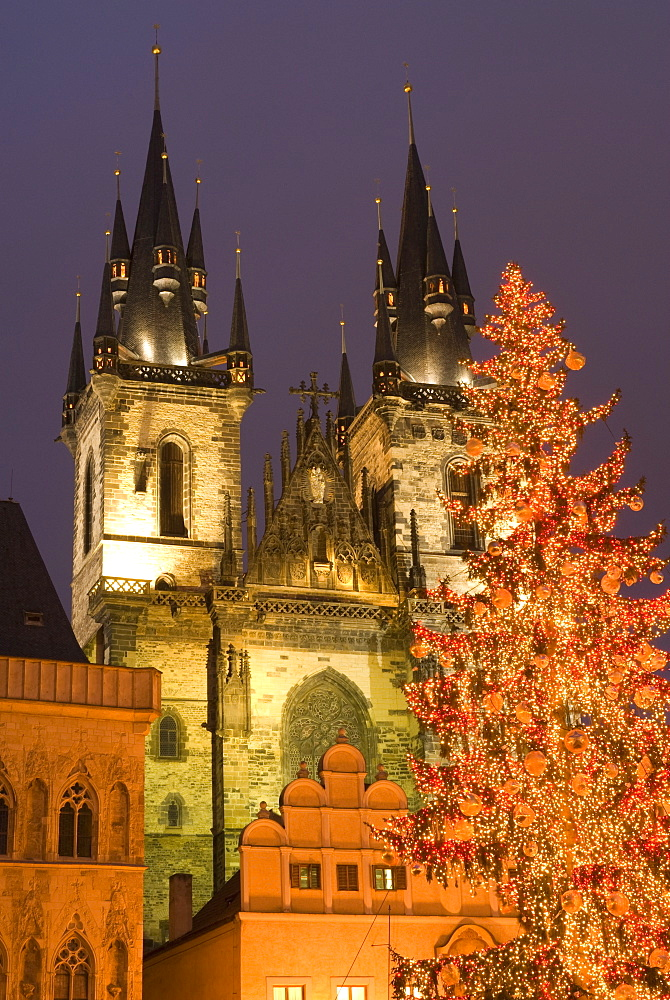 Christmas tree decoration and towers of Tyn Cathedral at Staromestske (Old Town Square), Stare Mesto, UNESCO World Heritage Site, Prague, Czech Republic, Europe