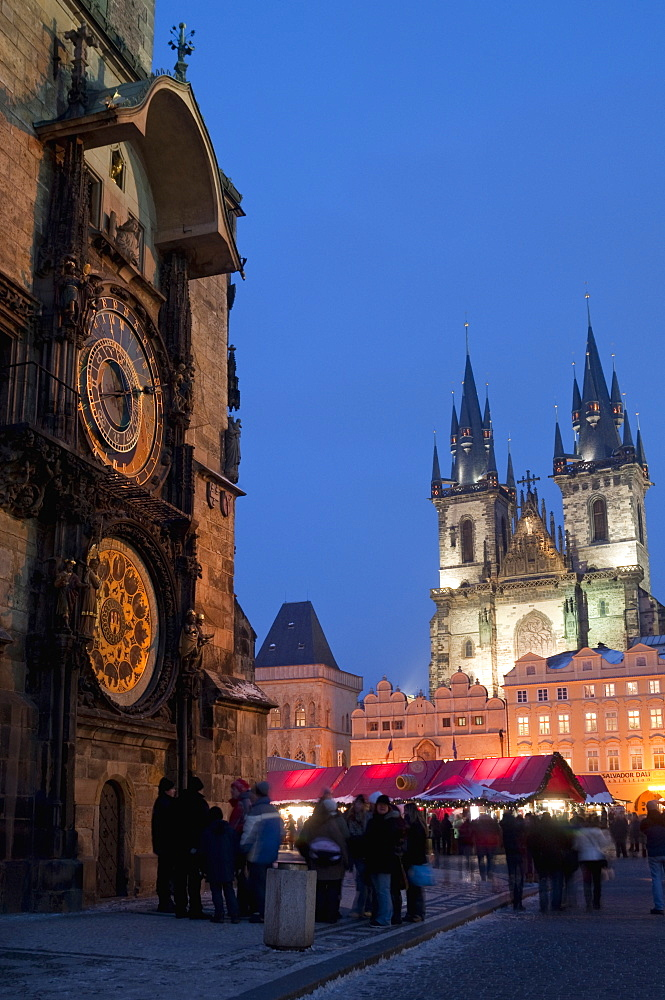 Astronomical Clock of Gothic Old Town Hall, stalls of Christmas Market, and Gothic Tyn Church, at twilight, Old Town Square, Stare Mesto, Prague, Czech Republic, Europe