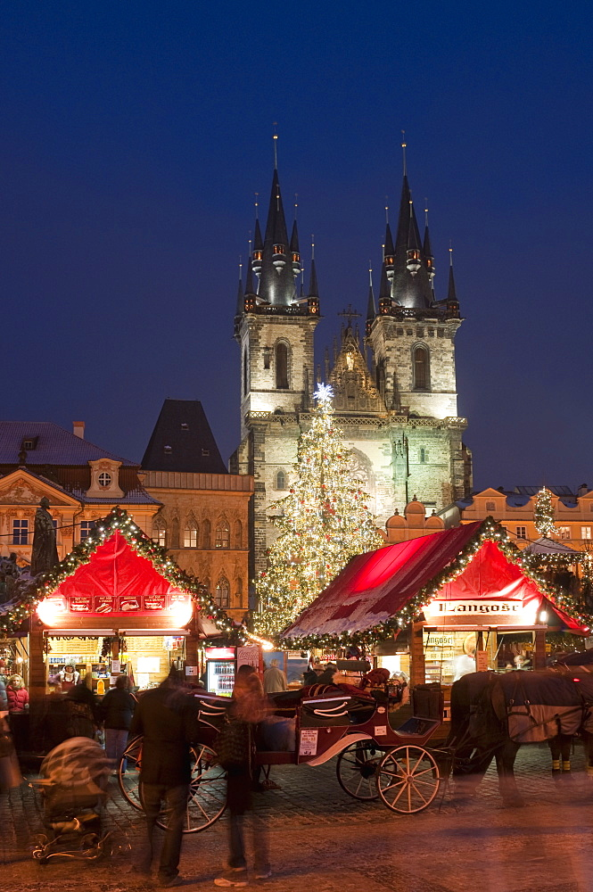 Horse drawn carriage at Christmas Market and Gothic Tyn Church at twilight, Old Town Square, Stare Mesto, Prague, Czech Republic, Europe