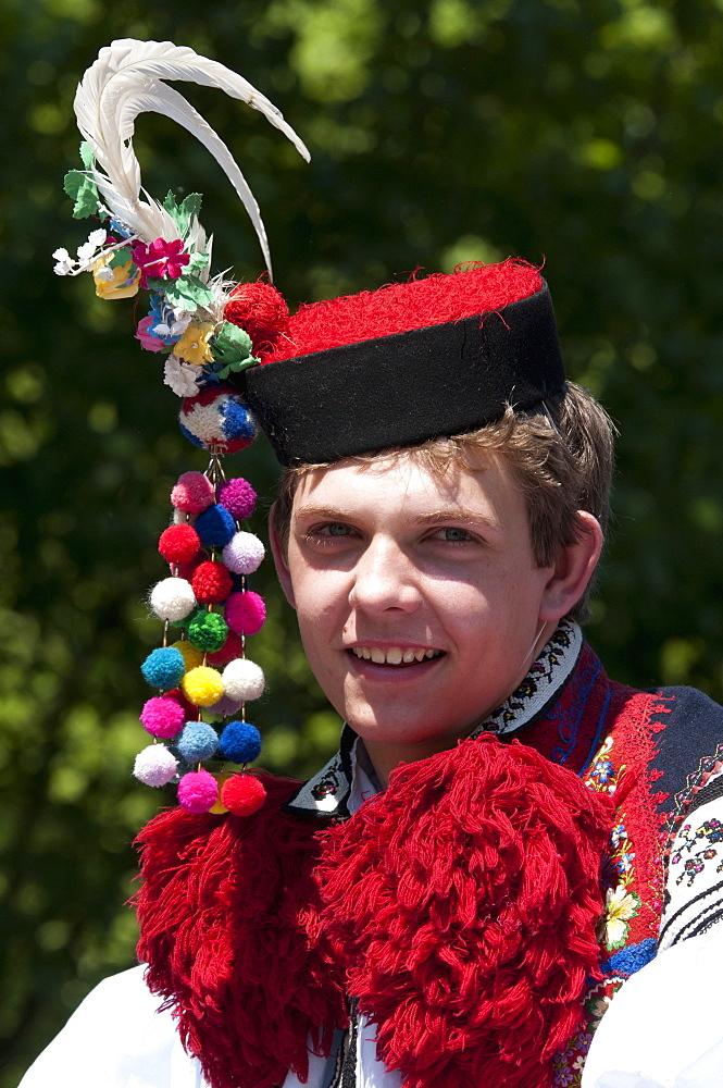 Young man wearing folk dress during festival The Ride of the Kings, Vlcnov, Zlinsko, Czech Republic, Europe