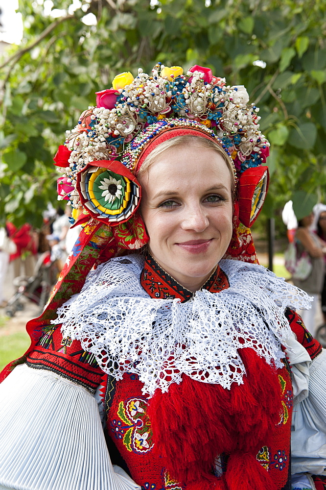 Woman wearing Vlcnov folk dress during Ride of the Kings festival, Vlcnov, Zlinsko, Czech Republic, Europe - 737-610