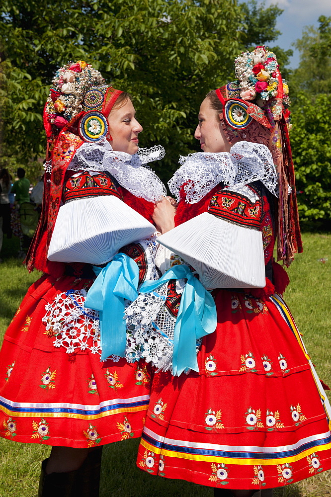 Young women wearing Vlcnov folk dress during Ride of the Kings festival, Vlcnov, Zlinsko, Czech Republic, Europe - 737-611