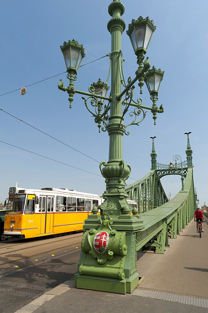 Tram and cyclist on Independence Bridge spanning Danube River, Budapest, Hungary, Europe - 737-640