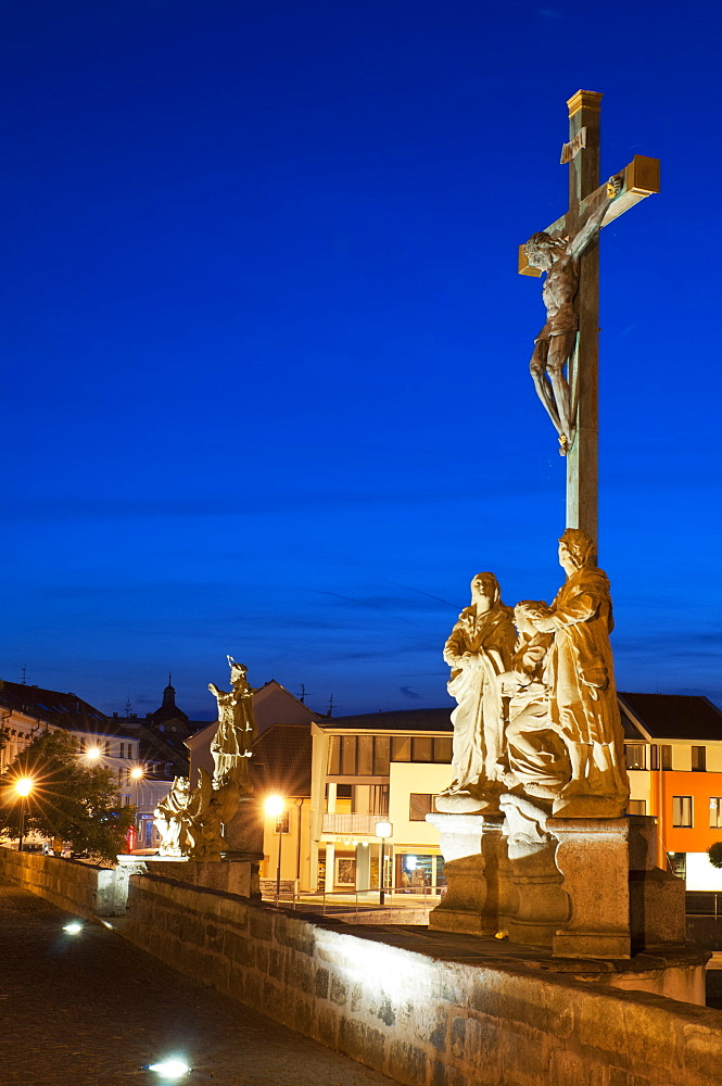 Statue of Crucified Jesus Christ on Kamenny Most, the oldest Gothic stone bridge in Czech Republic, at dusk, Pisek, Budejovicko, Czech Republic, Europe - 737-650