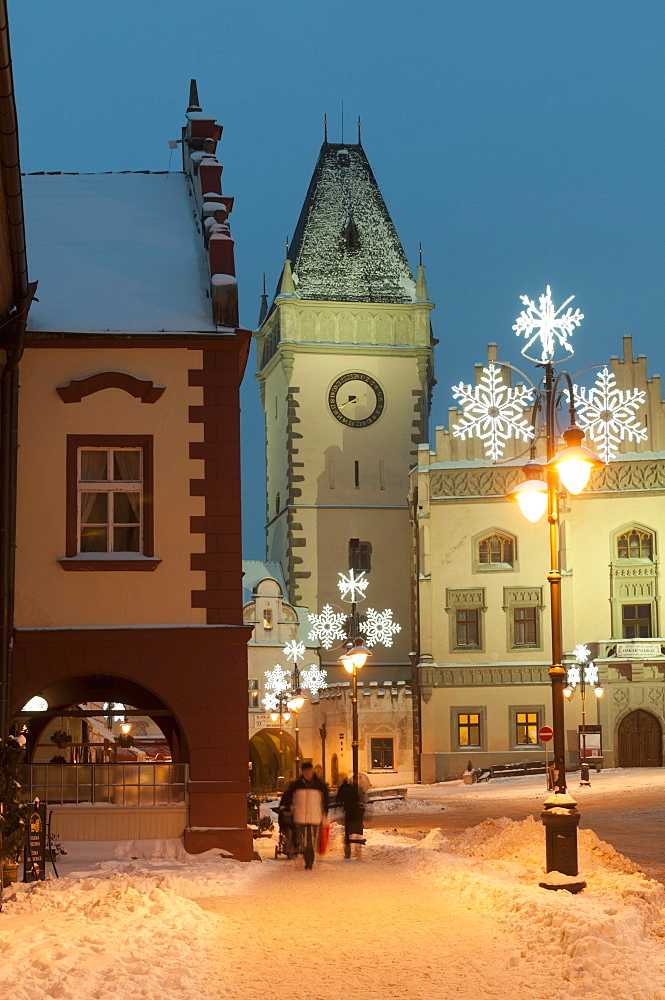 Snow-covered Christmas decorated lamps and Gothic Town Hall, Tabor, Jihocesky, Czech Republic, Europe  - 737-673