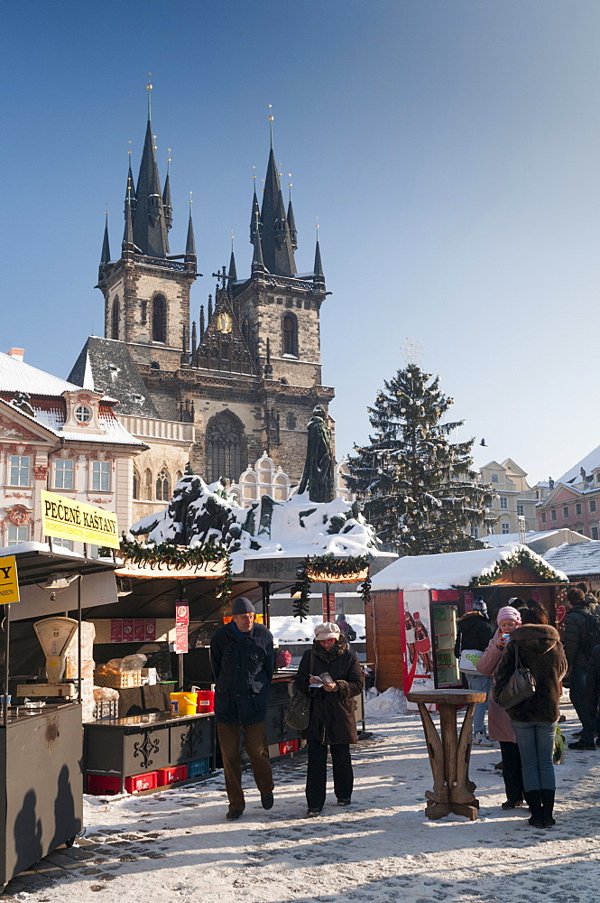 Snow-covered Christmas Market and Tyn Church, Old Town Square, Prague, Czech Republic, Europe - 737-678