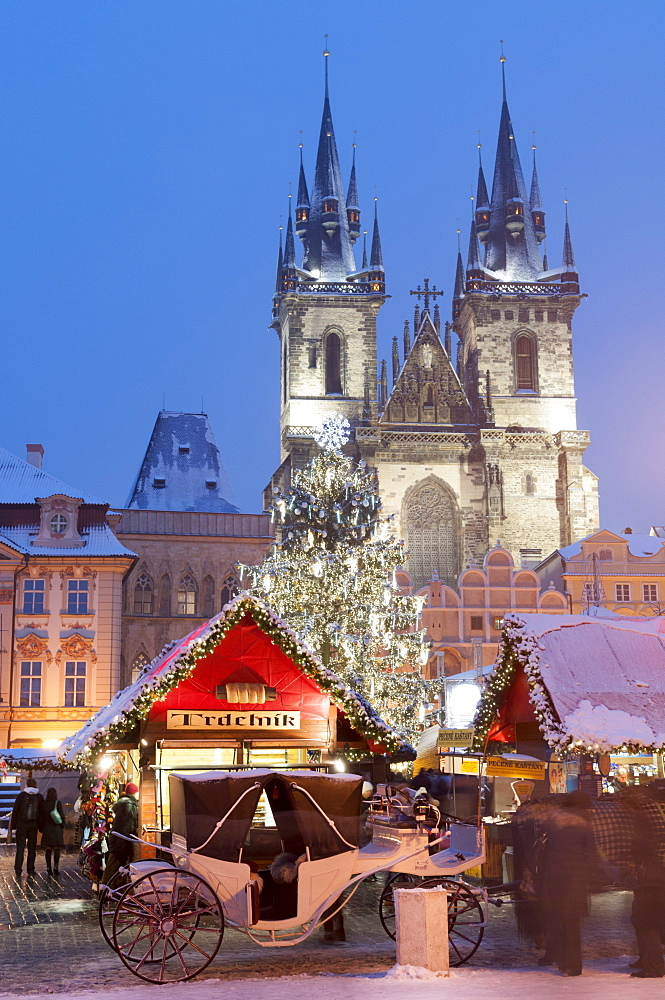 Snow-covered Christmas Market and Tyn Church, Old Town Square, Prague, Czech Republic, Europe - 737-682