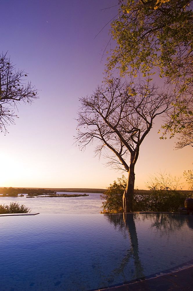 The River Club lodge, sunset on Zambesi River, Zambia, Africa