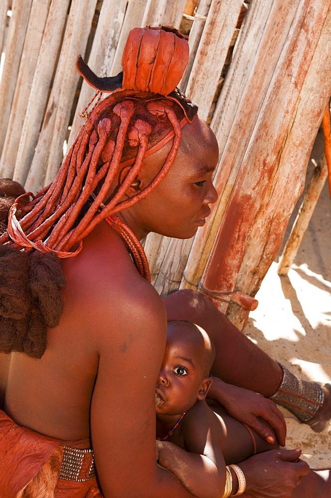 Himba woman and baby, Skeleton Coast National Park, Namibia, Africa