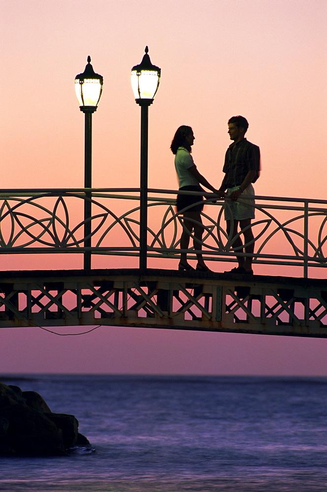 Couple on bridge, Aruba, West Indies, Dutch Caribbean, Central America - 741-730