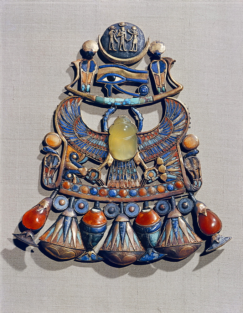 Pectoral in gold cloisonne with semi-precious stones and glass-paste, with winged scarab, symbol of resurrection, in centre, from the tomb of the pharaoh Tutankhamun, discovered in the Valley of the Kings, Thebes, Egypt, North Africa, Africa