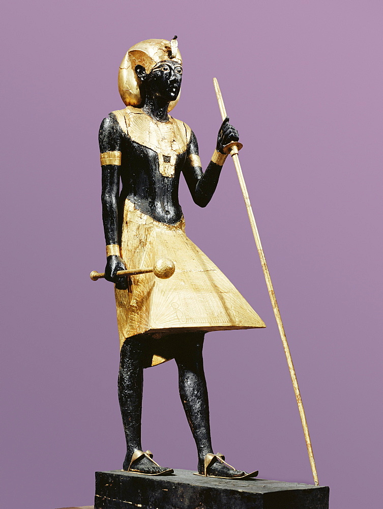 Life size statue of Tutankhamun made from black wood with applied gilded plaster, from the tomb of the pharaoh Tutankhamun, discovered in the Valley of the Kings, Thebes, Egypt, North Africa, Africa