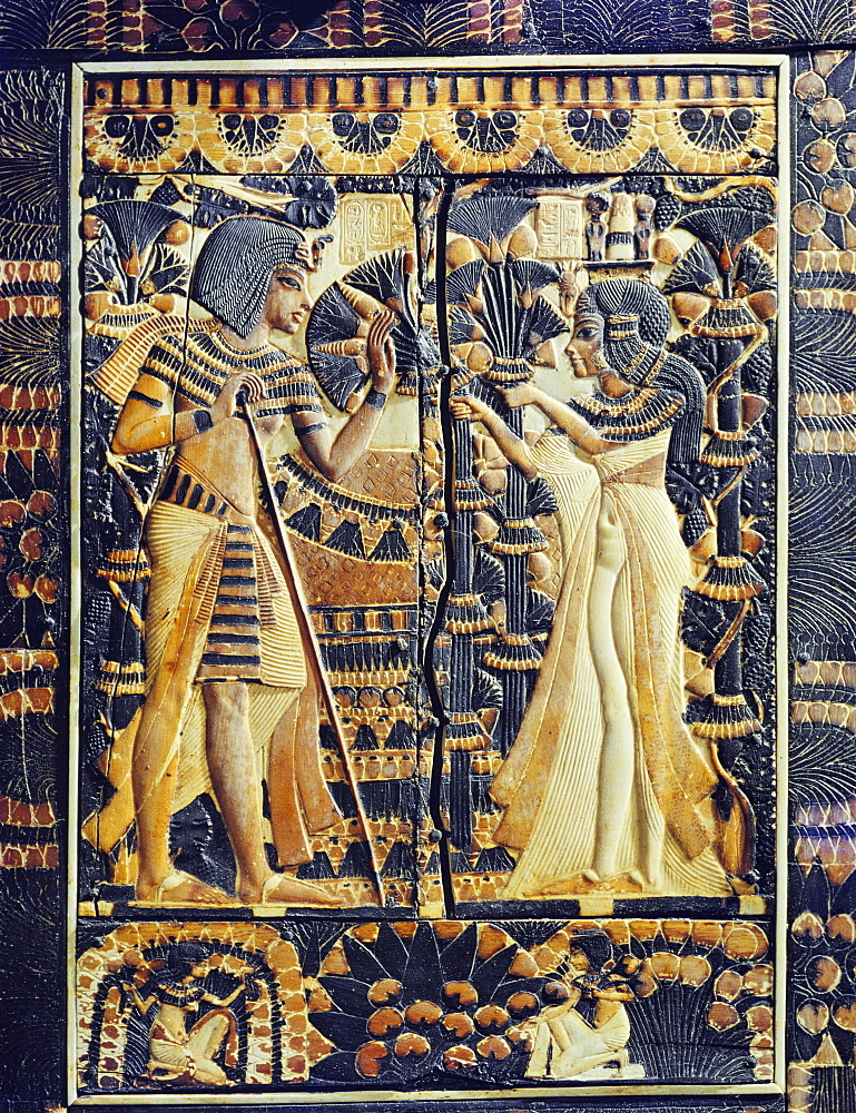 Painted ivory plaque from the lid of a coffer showing Tutankhamun and Ankhesenamun in a garden, the lower frieze shows young women plucking mandrakes, from the tomb of the pharaoh Tutankhamun, discovered in the Valley of the Kings, Thebes, Egypt, North Africa, Africa