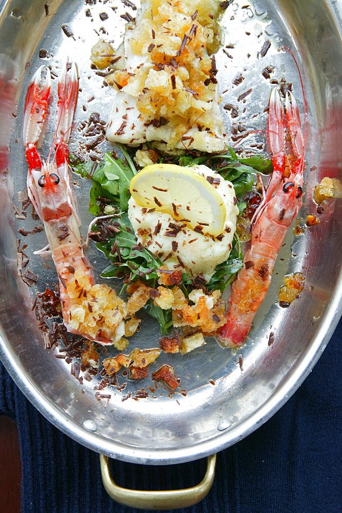 Cod fish and prawn au gratin with truffle on lemon cream, Orestorante restaurant, Ponza island, Lazio, Italy