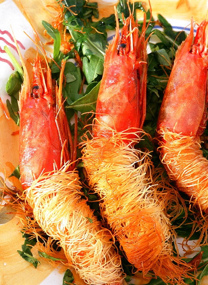 "Big crayfishes in ""Kataifi"" pasta and sea urchin mayonnaise, Orestorante restaurant, Ponza island, Lazio, Italy"