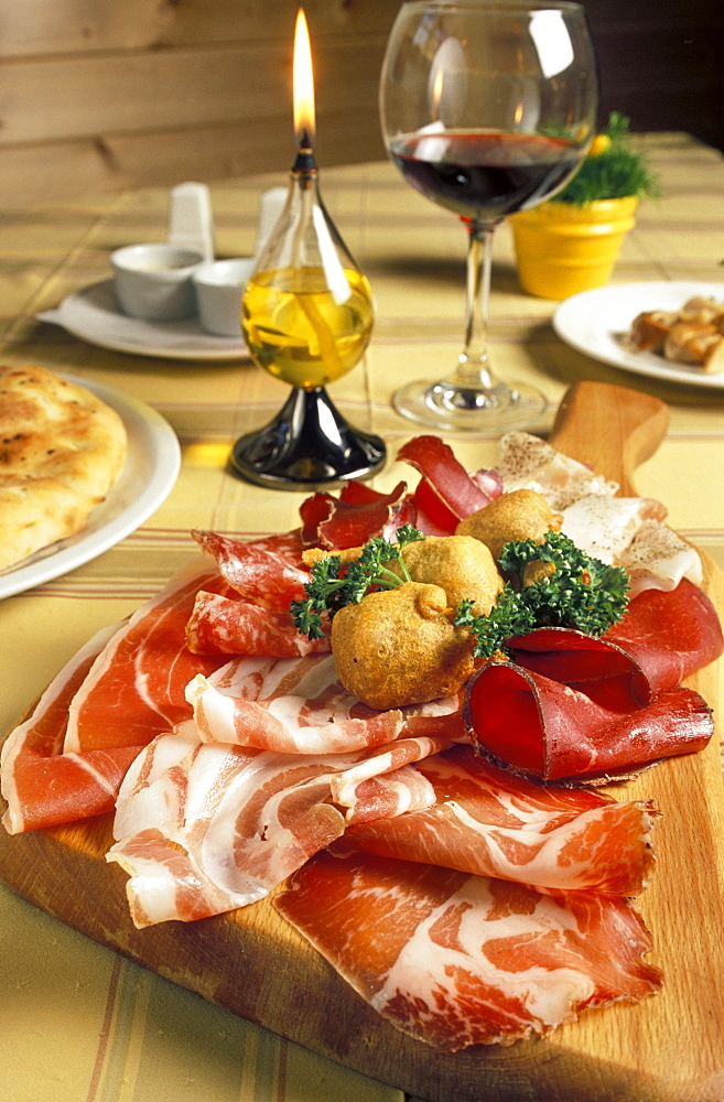 Chopping board with salami, Al Frodolfo restaurant, Santa Caterina Valfurva, Lombardy, Italy